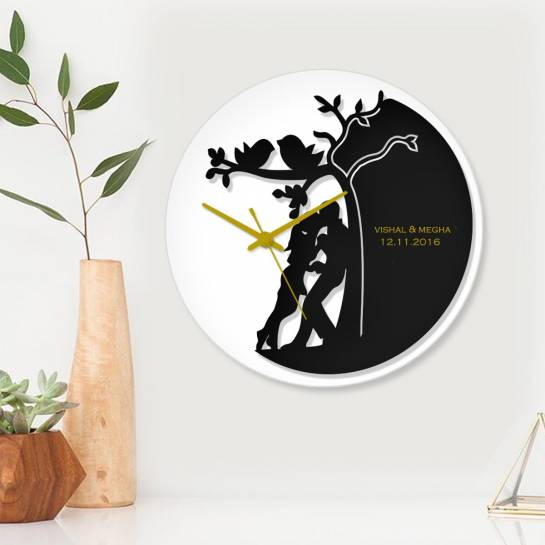 couple kissing designer wall clock