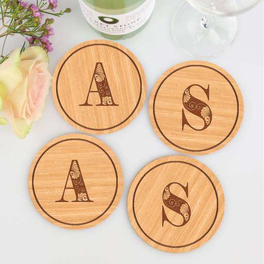 Wooden coasters with letter engravings